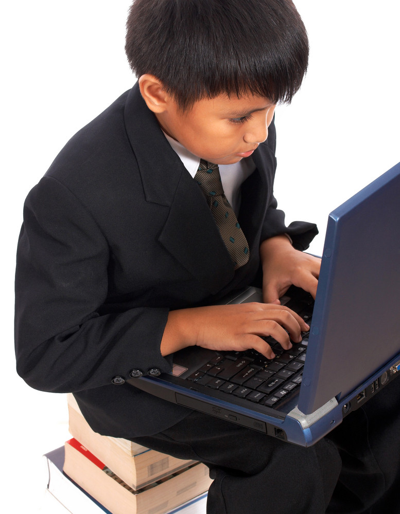 Boy Doing His Homework On His Computer