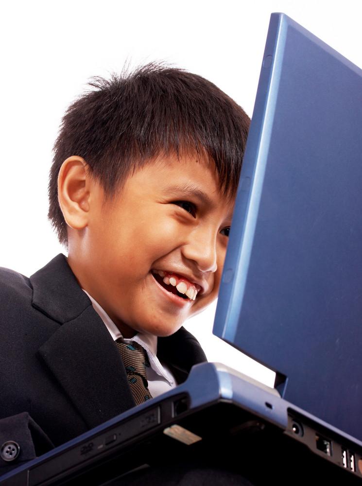 Boy Having Fun On The Computer