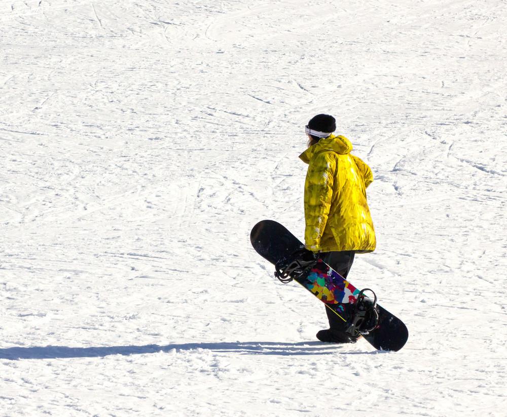 Boy Holding A Snowboard