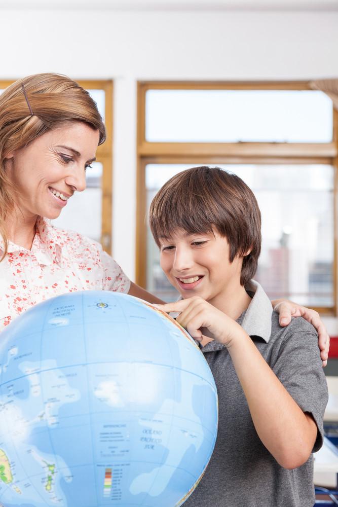 boy learning geography