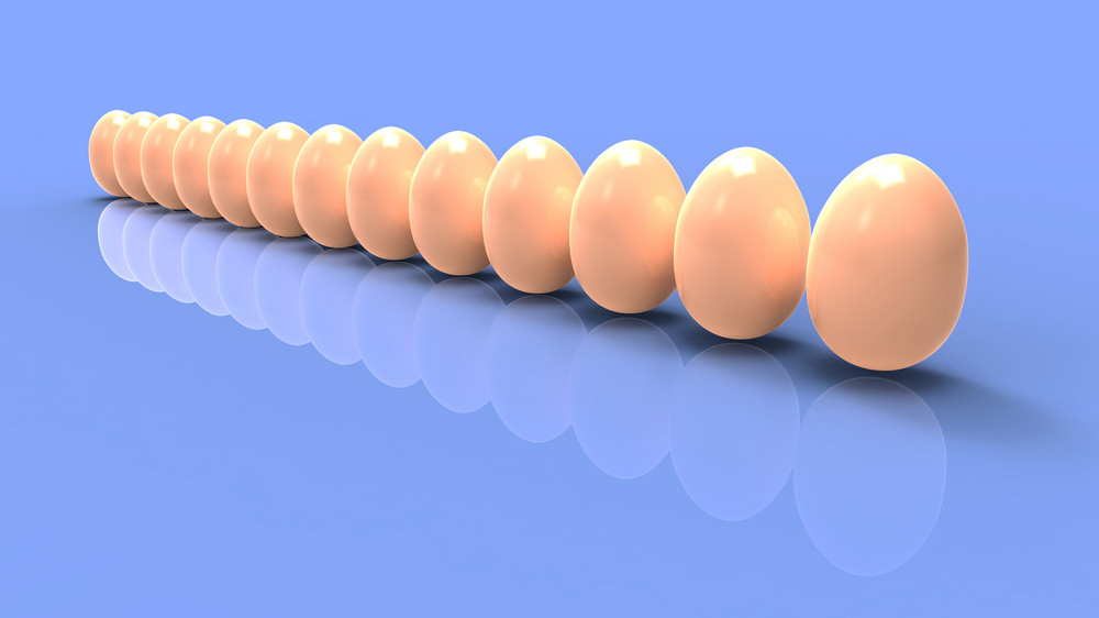 Brown Eggs In Line On Blue Background.