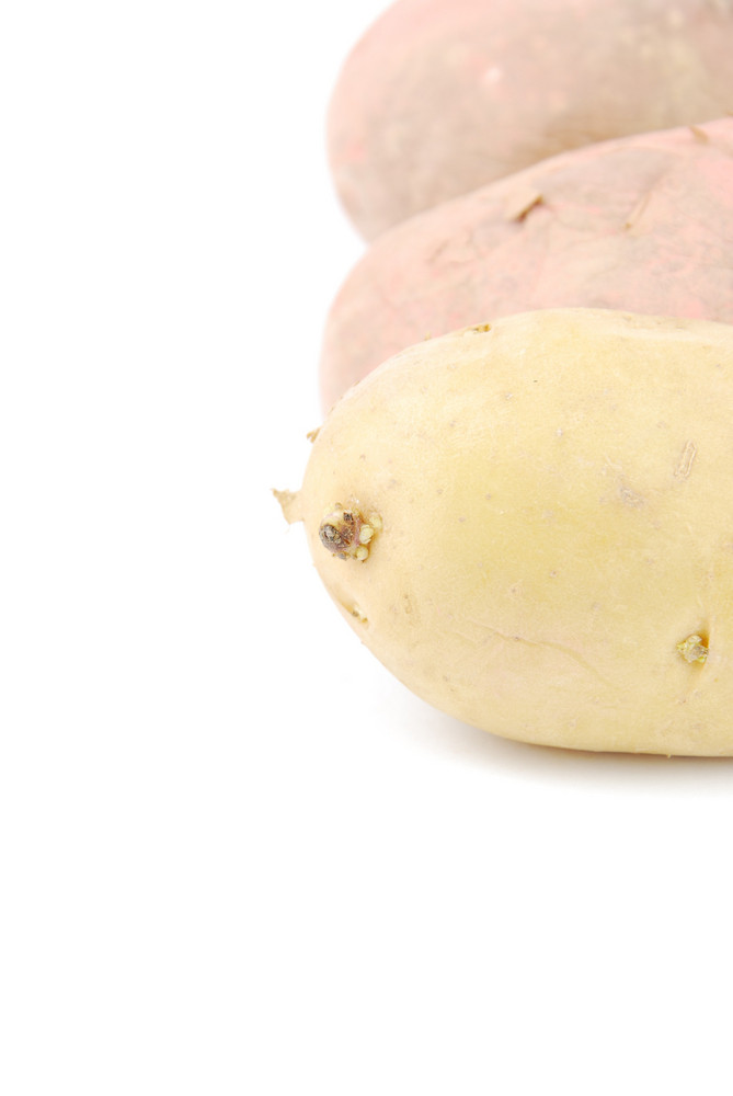 Bunch Of Potatoes On White