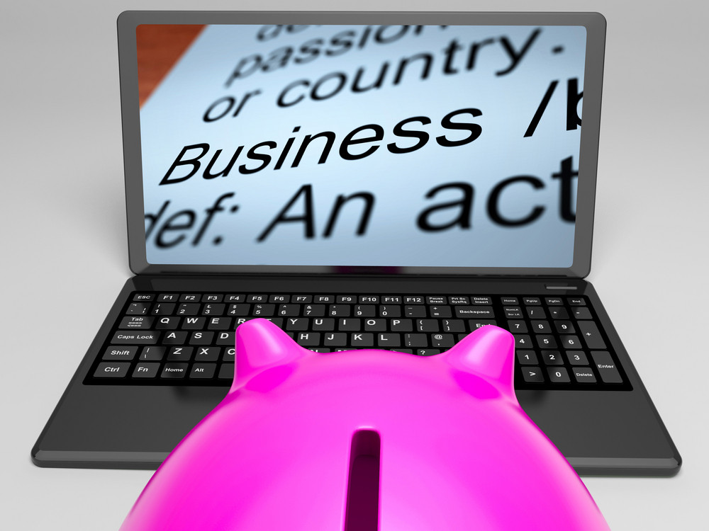 Business Definitions On Laptop Shows Monetary Transactions