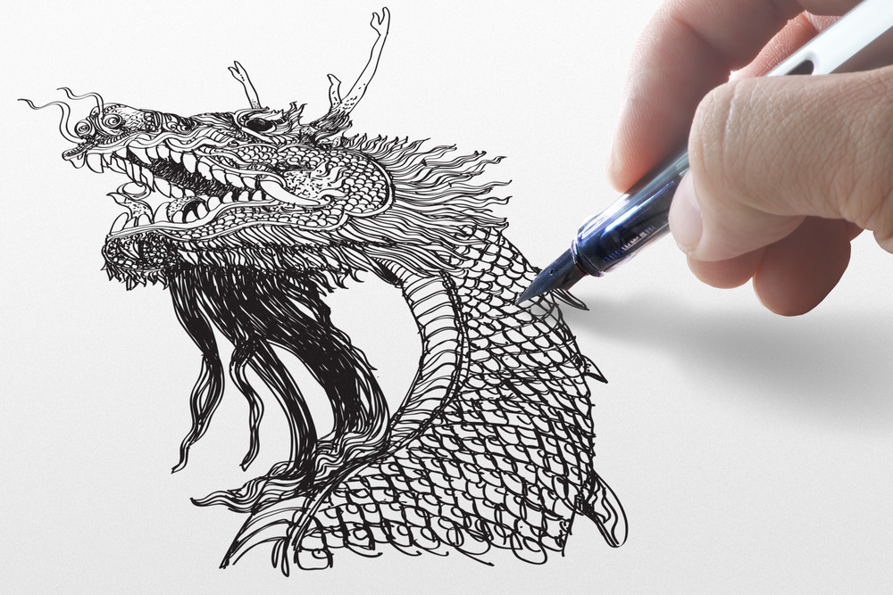 Business Hand Draws A Dragon