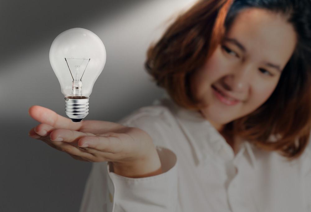 Business Hand Show Light Bulb