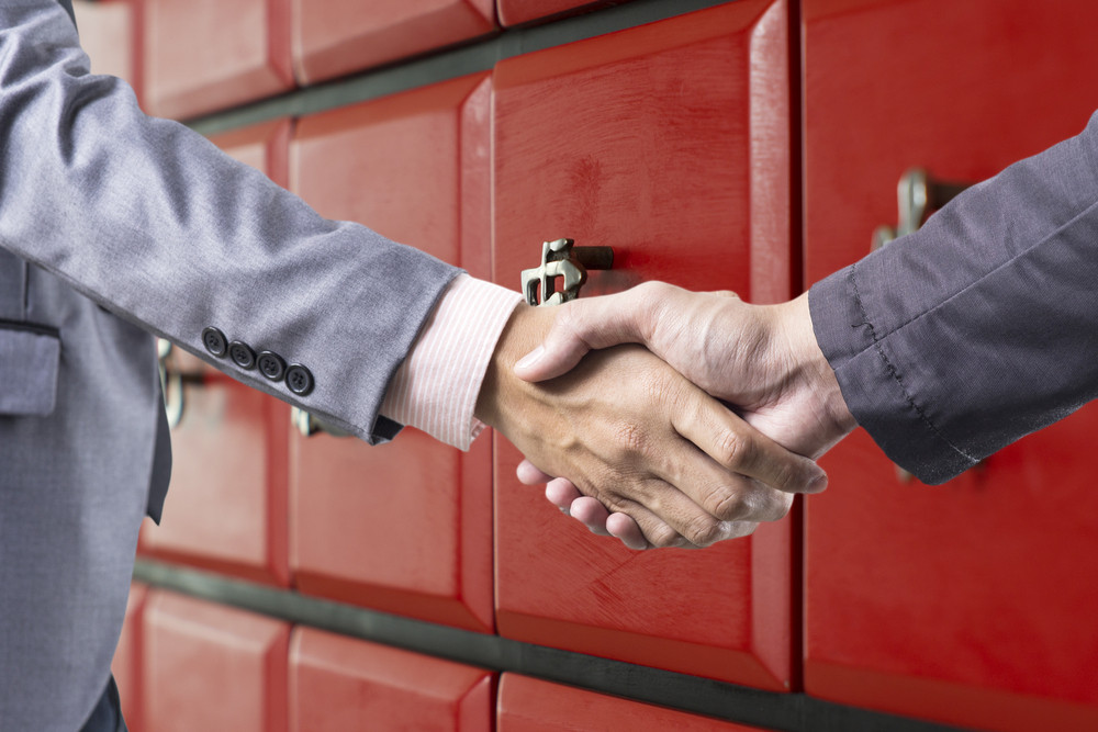 Business handshake on red china style background