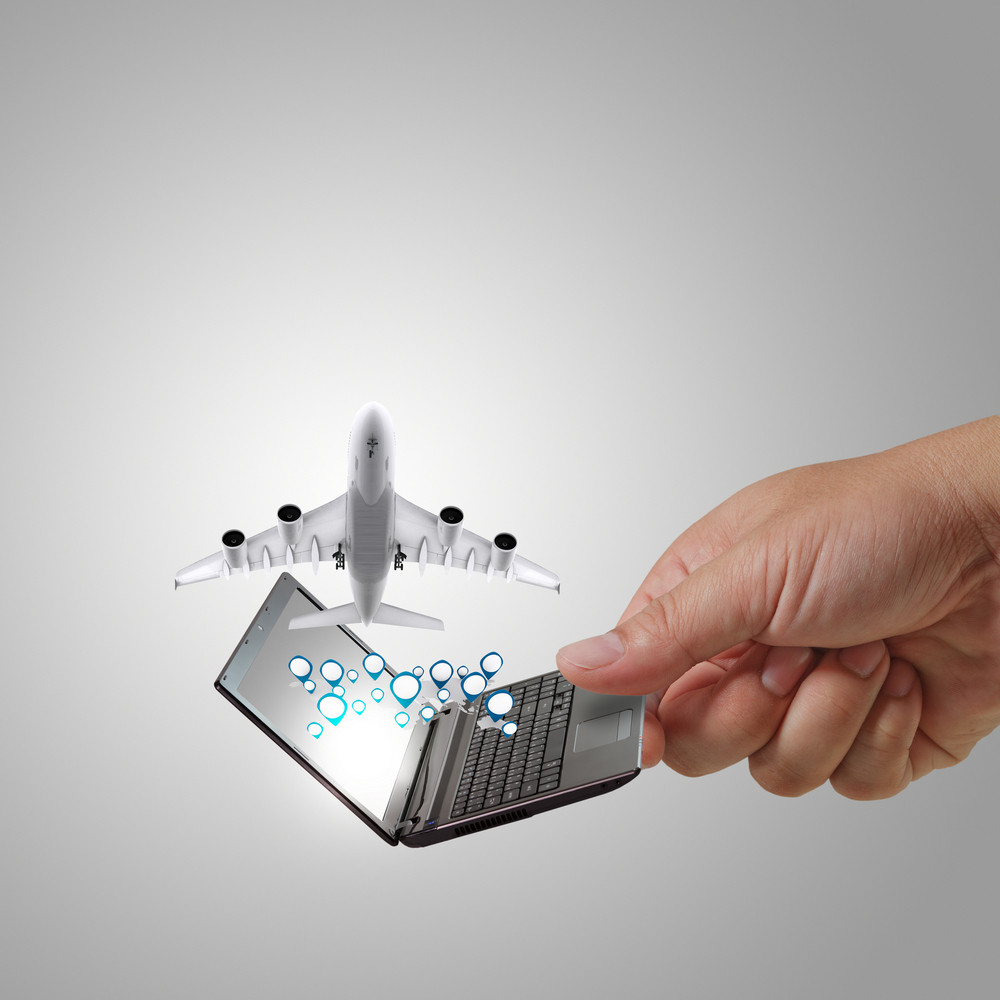 Business Man Hand Holds Laptop And Dream Travel