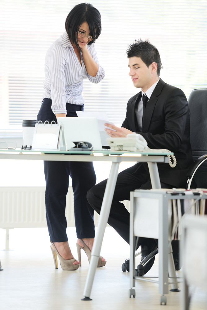 Business people having consulting about project in office