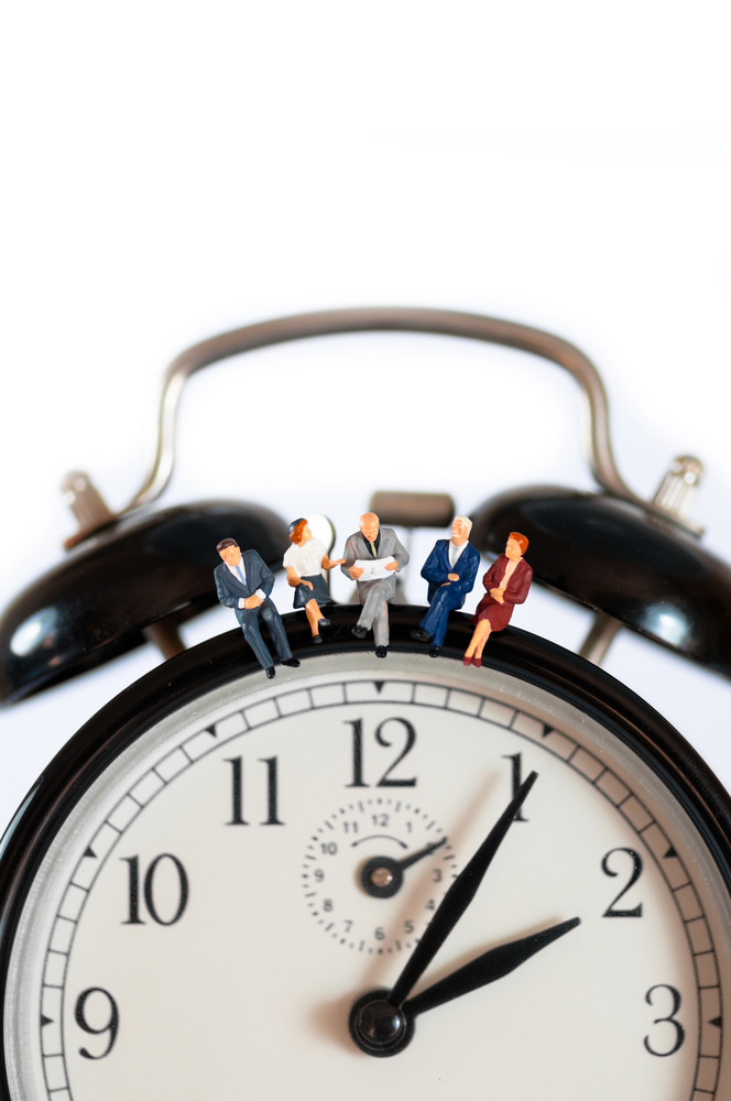 Business Team Sitting On Top Of Giant Clock