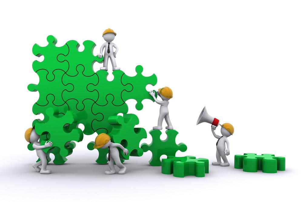 Trabalho de equipe de negócios que constrói um quebra-cabeça. Buuilding Business Concept.