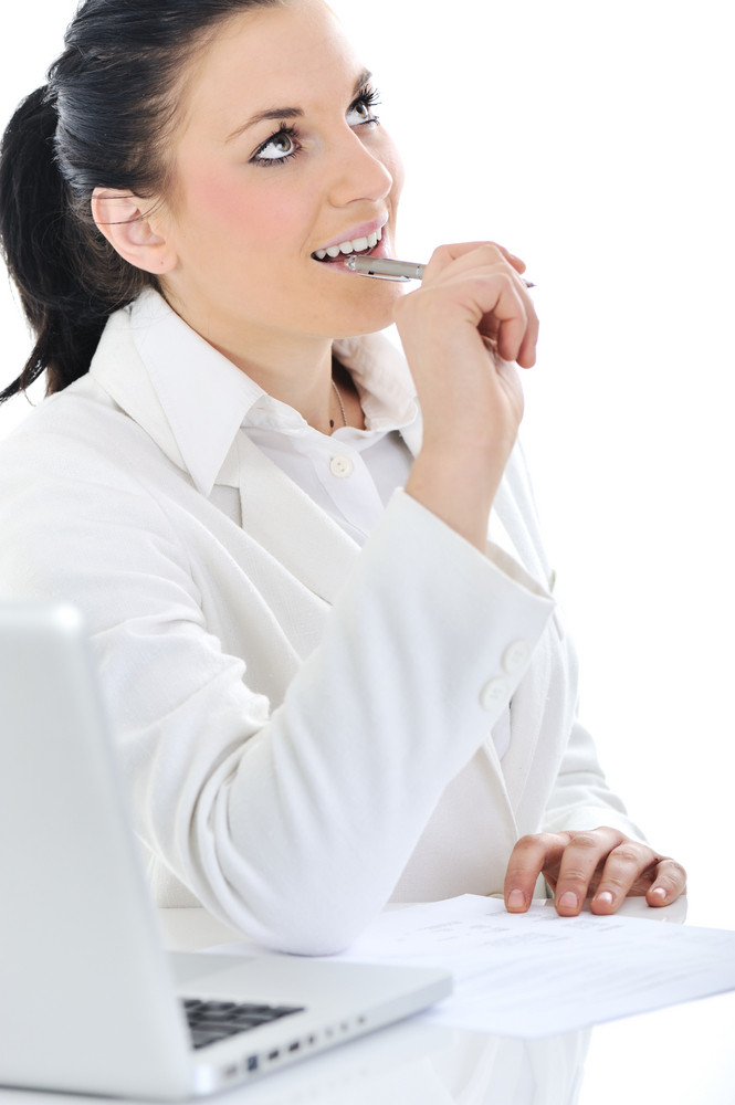 Business woman on desk working on laptop