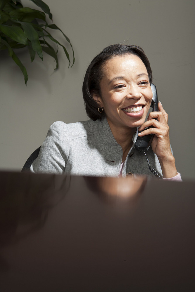 Business woman sitting at desk in office
