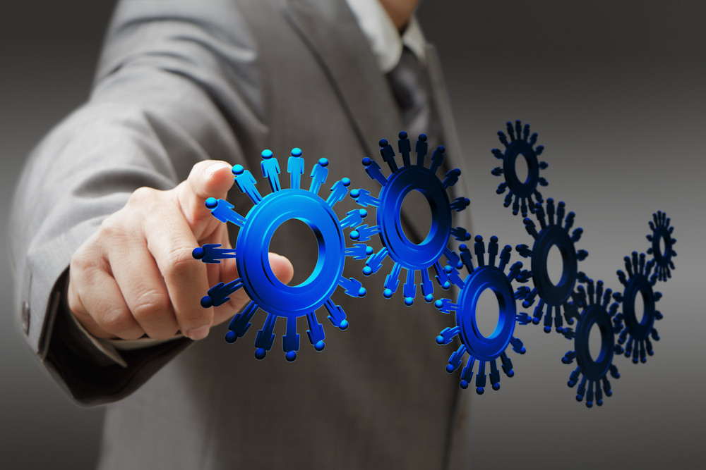 Businessman And People Cogs As Concept