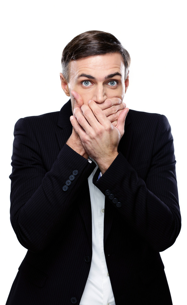 Businessman covering his mouth over white background