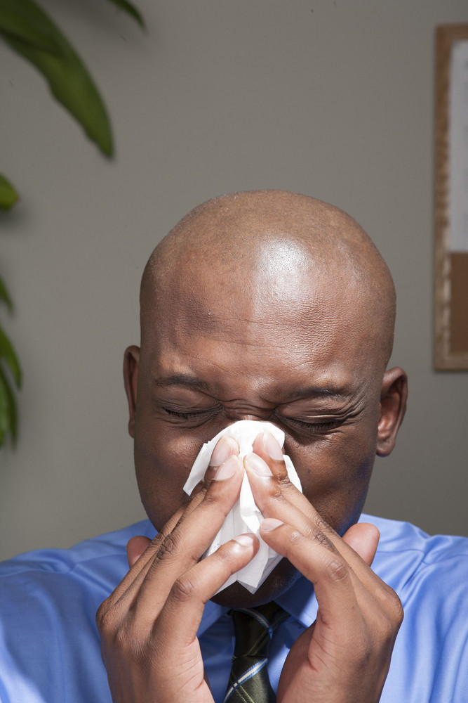 Businessman feeling sick in office