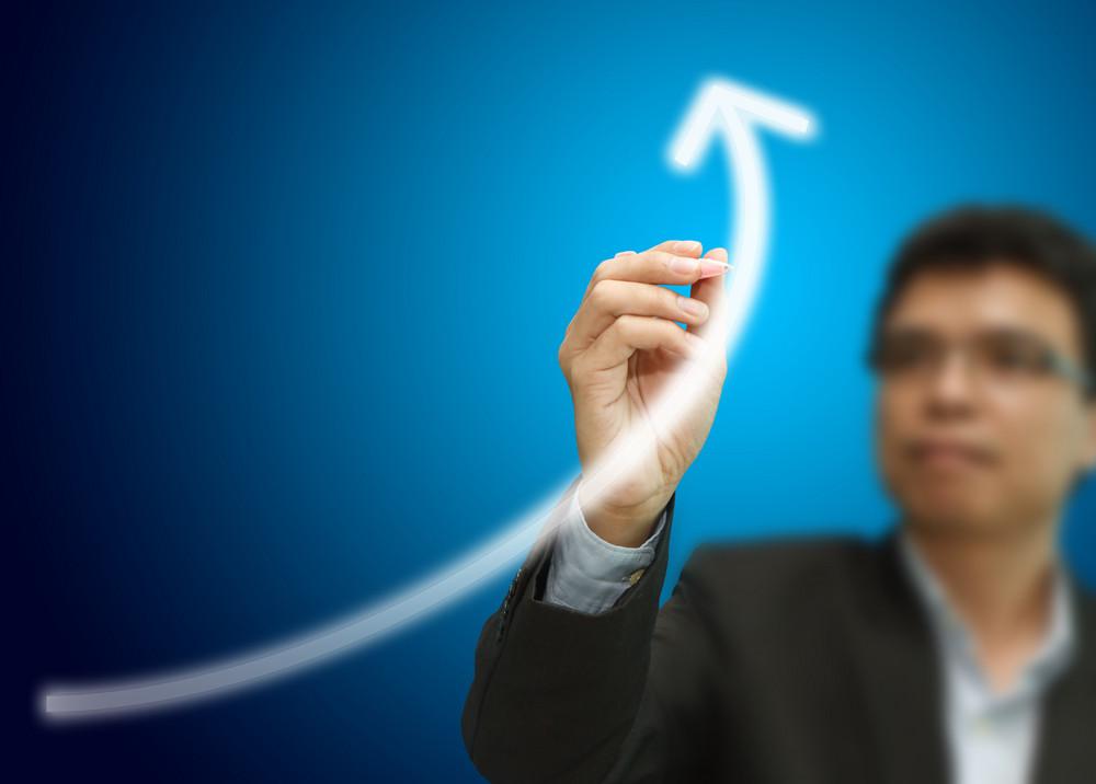 Businessman Hand Drawing A Grow Graph