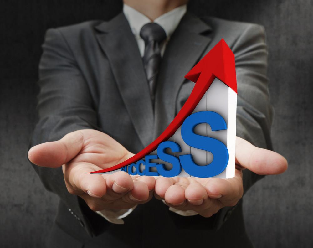 Businessman Hand Shows 3d Success Of Business As Concept