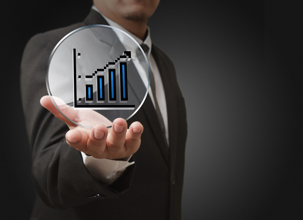 Businessman Hand Shows Pixel Graph