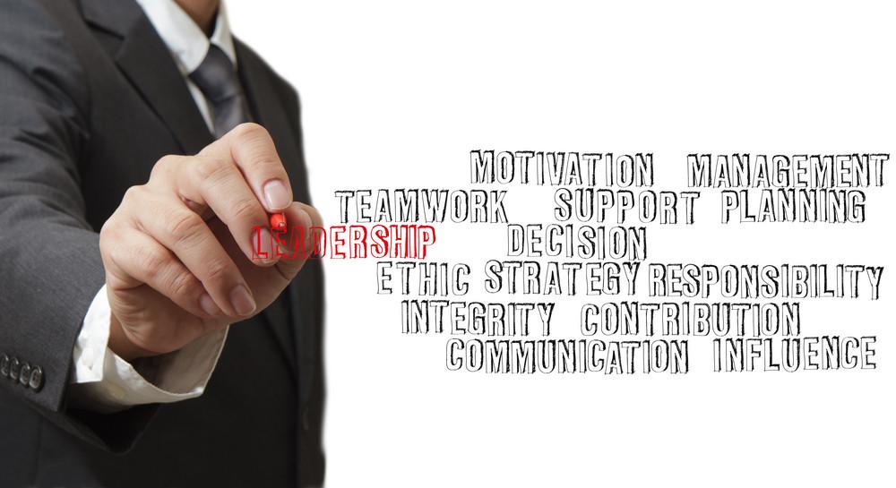 Businessman Hand Writing Leadership Skill