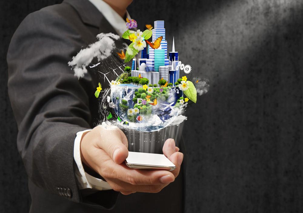 Businessman Holding A Mobile Phone Sending Images