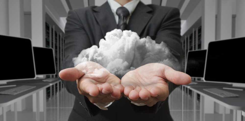 Businessman Holding Cloud In Hands