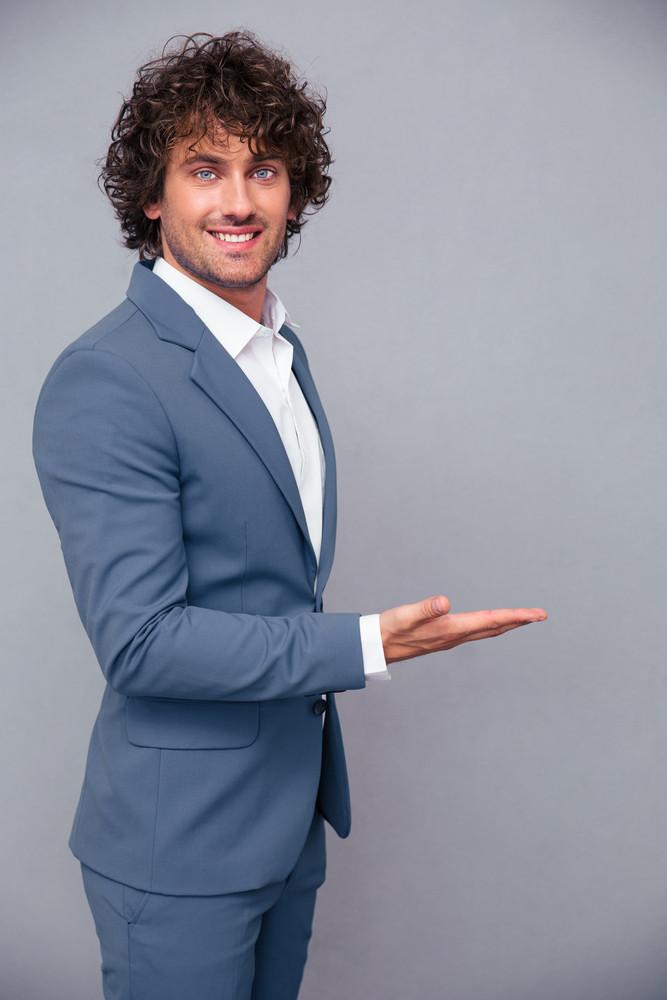 Businessman holding copyspace on hand