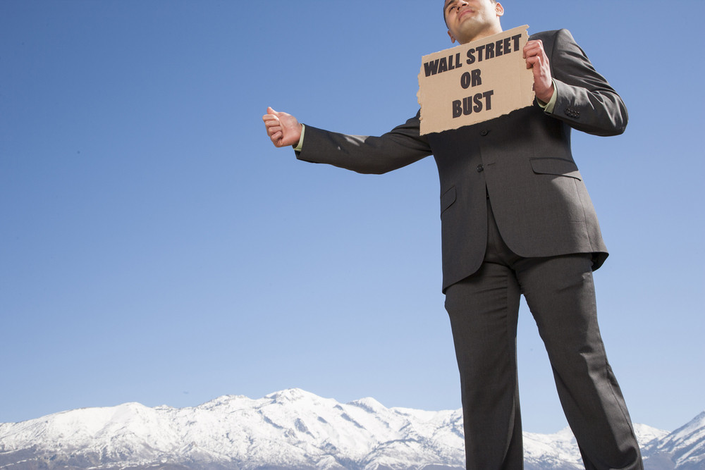 Businessman holding sign outside