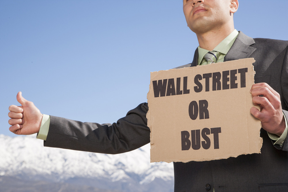 Businessman holding sign outside