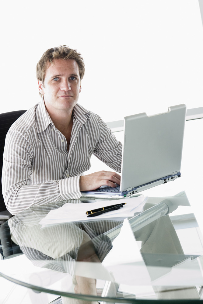 Businessman in boardroom with laptop