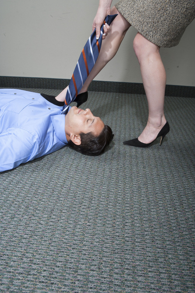Businessman on floor in office