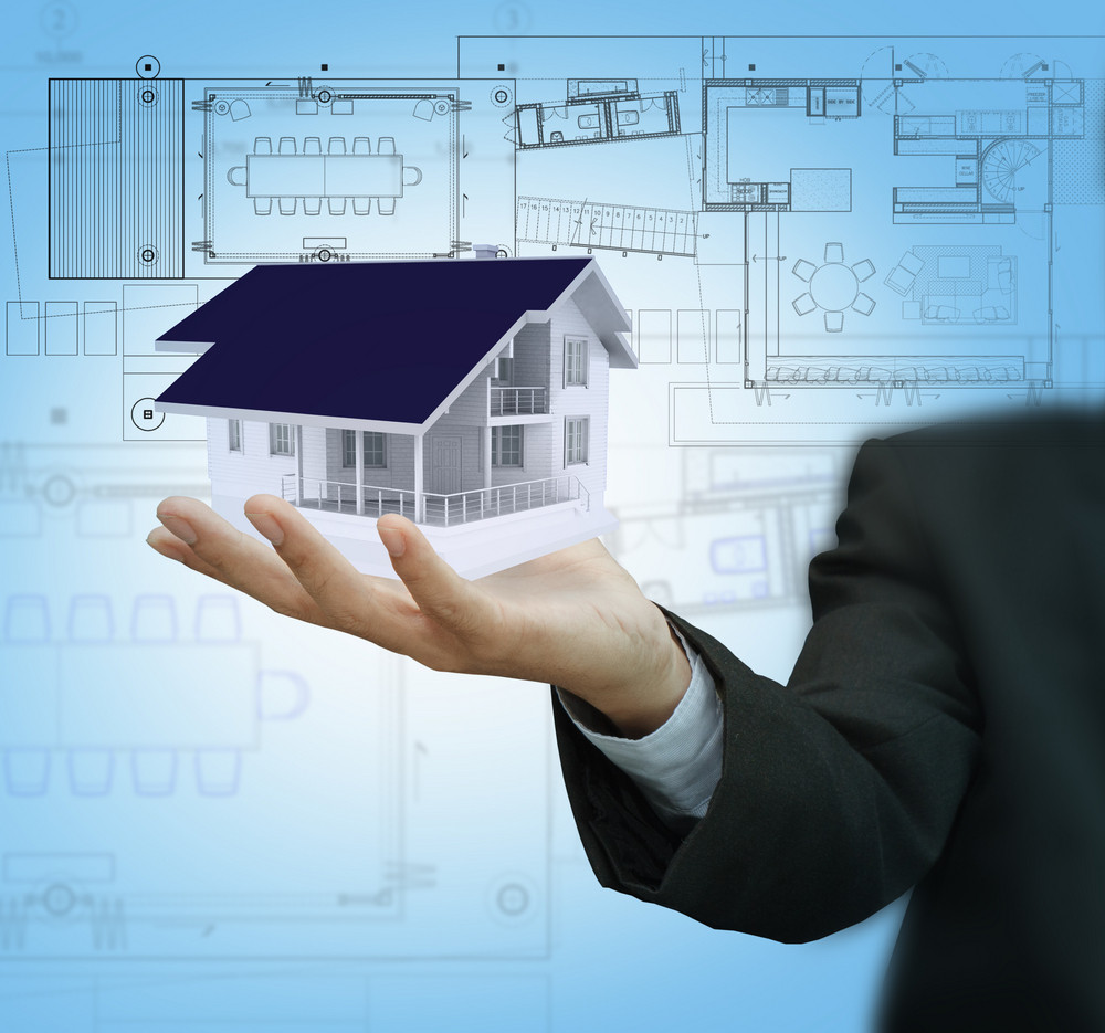 Businessman Present House Model And Plan On Touch Screen