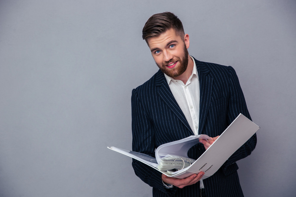 Businessman reading document in folder