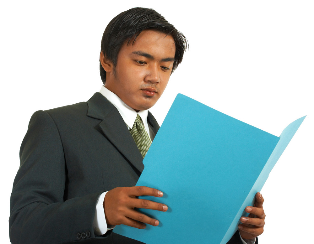 Businessman Reviewing A Folder