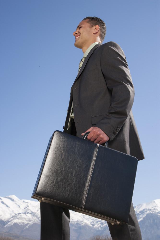 Businessman walking outside