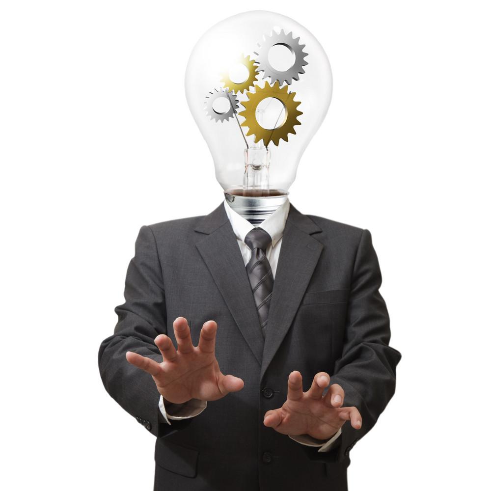 Businessman With Gears In Light Bulb Head
