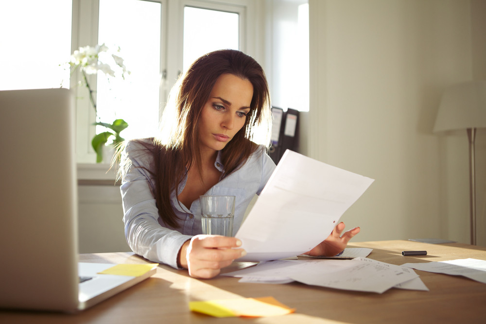 https://d1yn1kh78jj1rr.cloudfront.net/image/preview/rDtN98Qoishumwih/businesswoman-reading-a-document-young-woman-sitting-at-her-desk-going-through-a-contract-beautiful-caucasian-woman-working-at-home-office_B6Wz2bLEKe_SB_PM.jpg