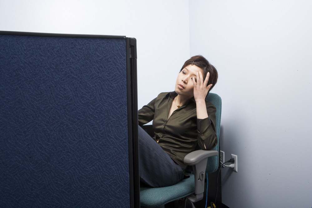 Businesswoman tired in cubicle