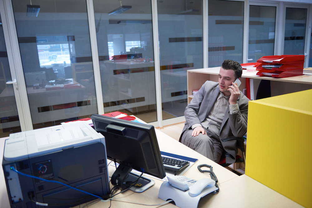 Business Man Talking By Phone In Office