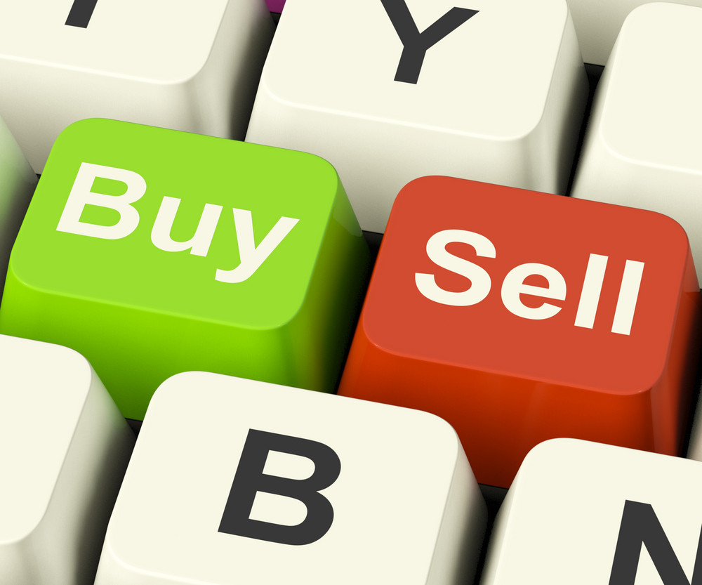 Buy And Sell Keys Representing Business Trade Or Stocks Online