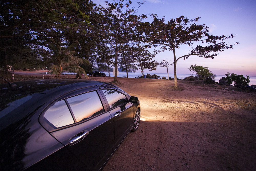 Car with sunset viewpoint