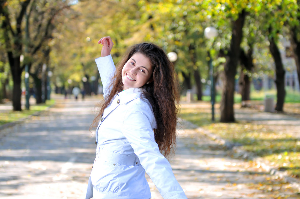 Young woman smiling outdoors in nature