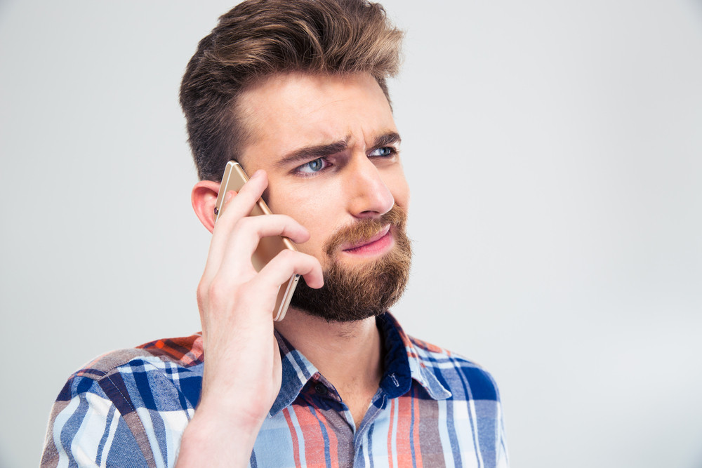 Casual young man talking on the phone