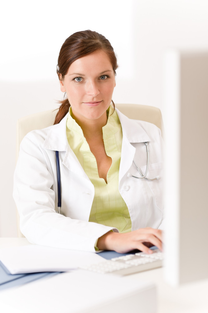 Female doctor at medical office with computer