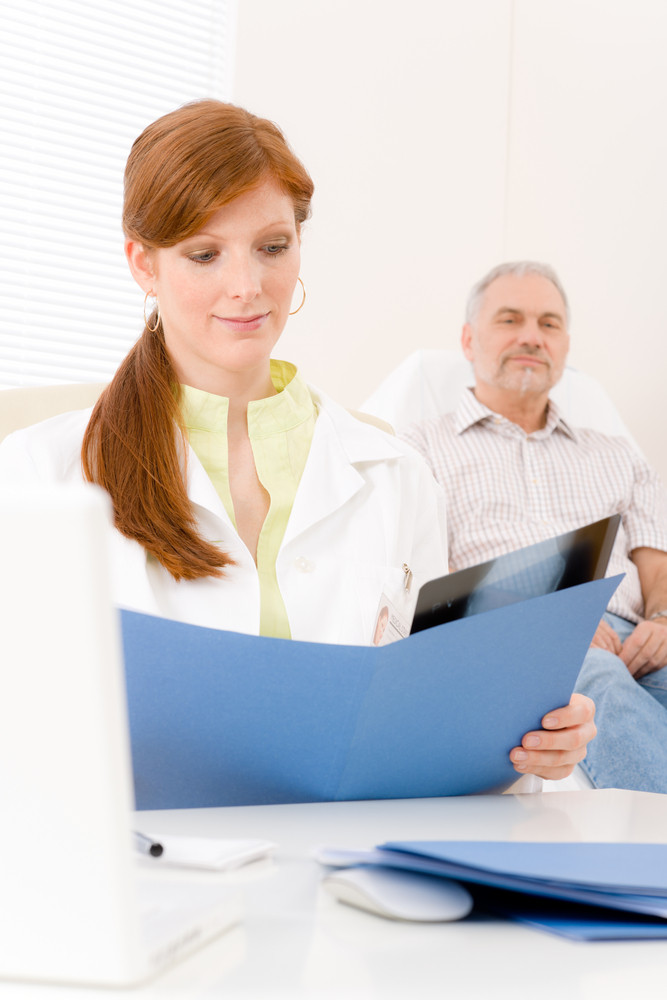 Doctor office - female physician examine senior patient x-ray
