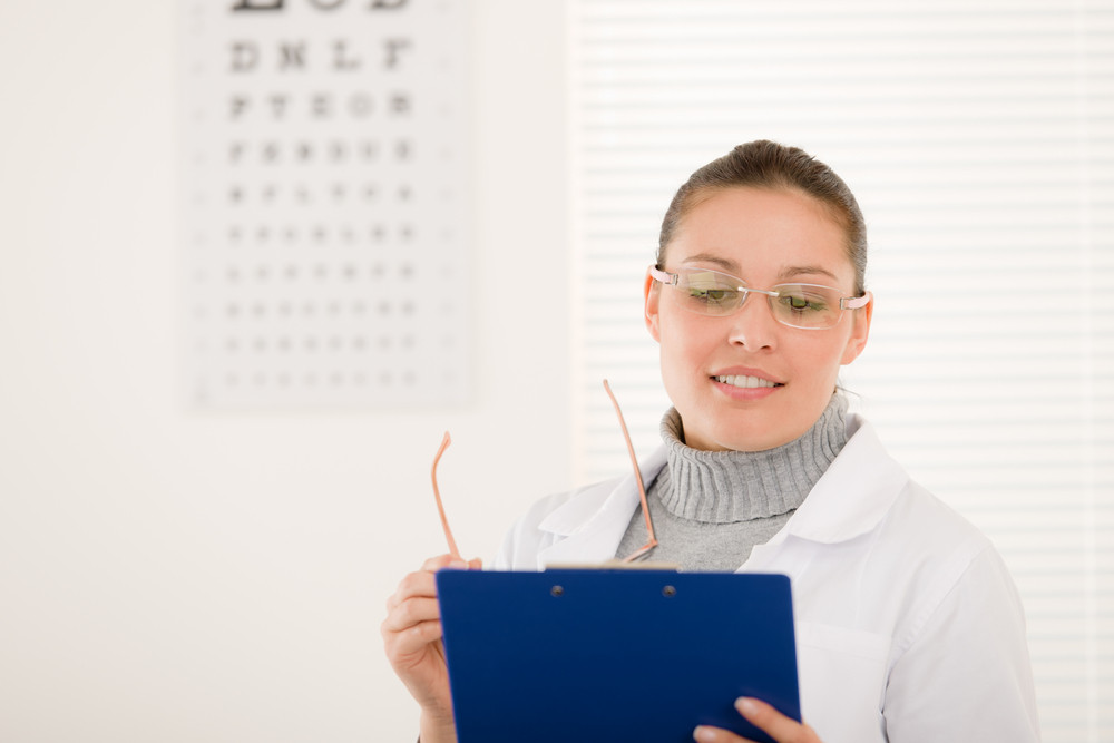 Optician Doctor Woman With Prescription Glasses And Eye Chart