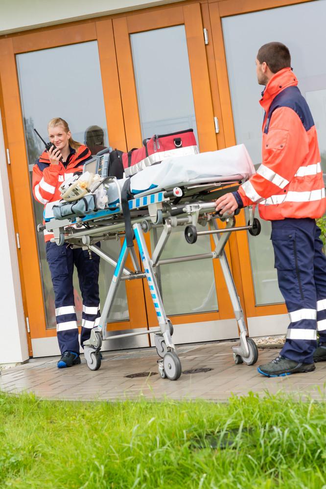 Paramedics emergency home visit call radio ambulance doctor help