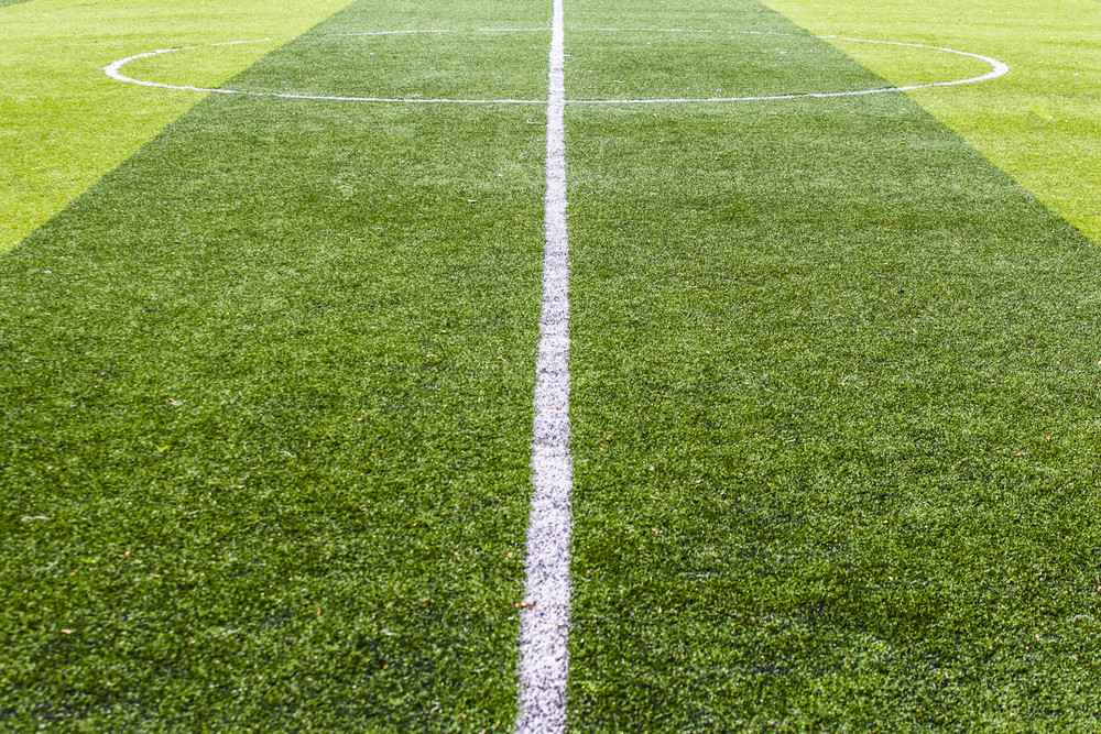 Centre soccer green field background
