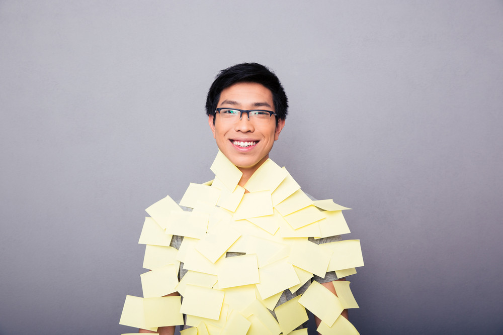 Cheerful asian man pasted stickers