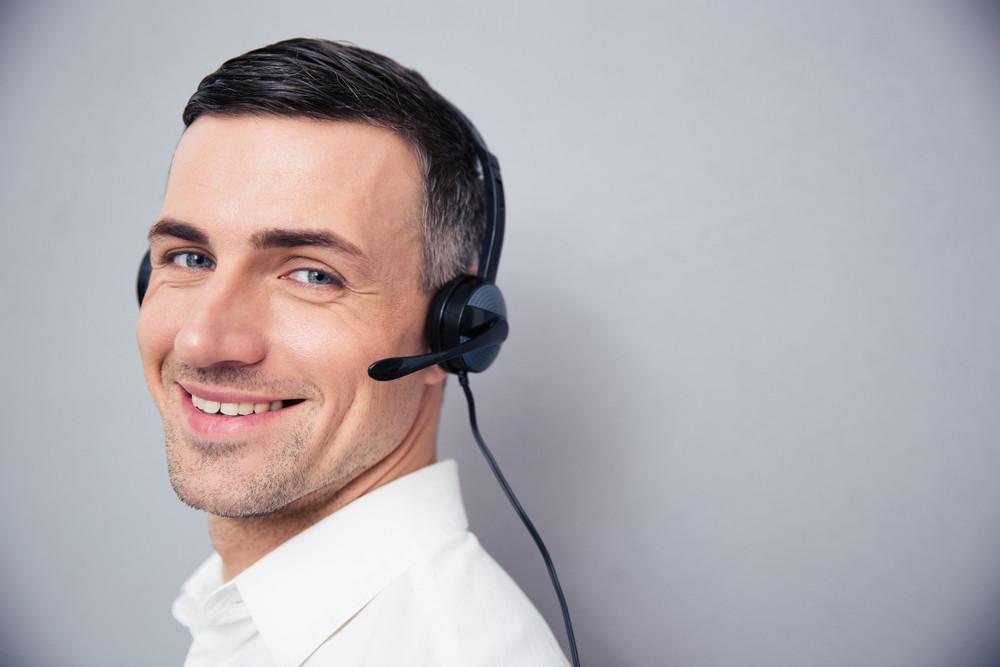 Cheerful businessman in headphones