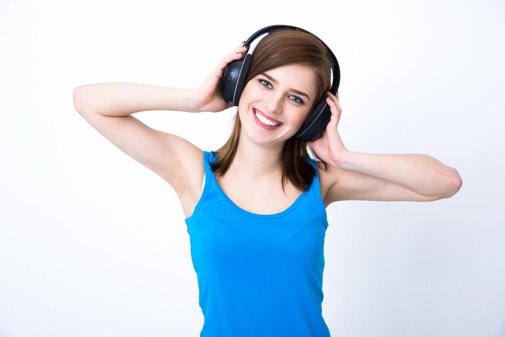Cheerful woman with headphones listening music